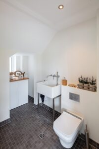 Renovation of an understairs toilet in Wicklow incliding wet room drain, concealed cistern and Belfast style sink