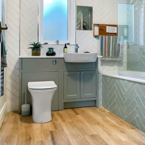 Kildare bathroom renovation with wood effect porcelain floor tiles, herringbone wall tiles and in frame designer vanity unit