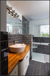 Bathroom renovation in county Wexford with bespoke vanity unit, custom shower screen, wetroom shower and built in bath