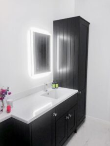 Bathroom refurbishment Wexford with bespoke vanity unit and seamless white corian sink and counter
