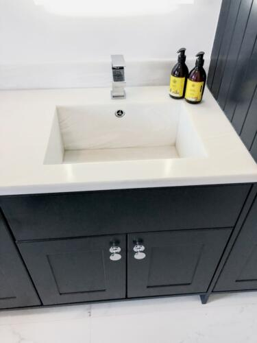 Seamless corian sink in custom made vanity unit Gorey