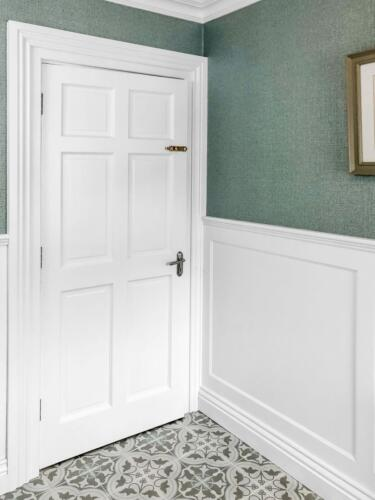 Traditional bathroom tiles with wall panelling and wallpaper